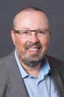 Porträtbild von Kreis Thomas